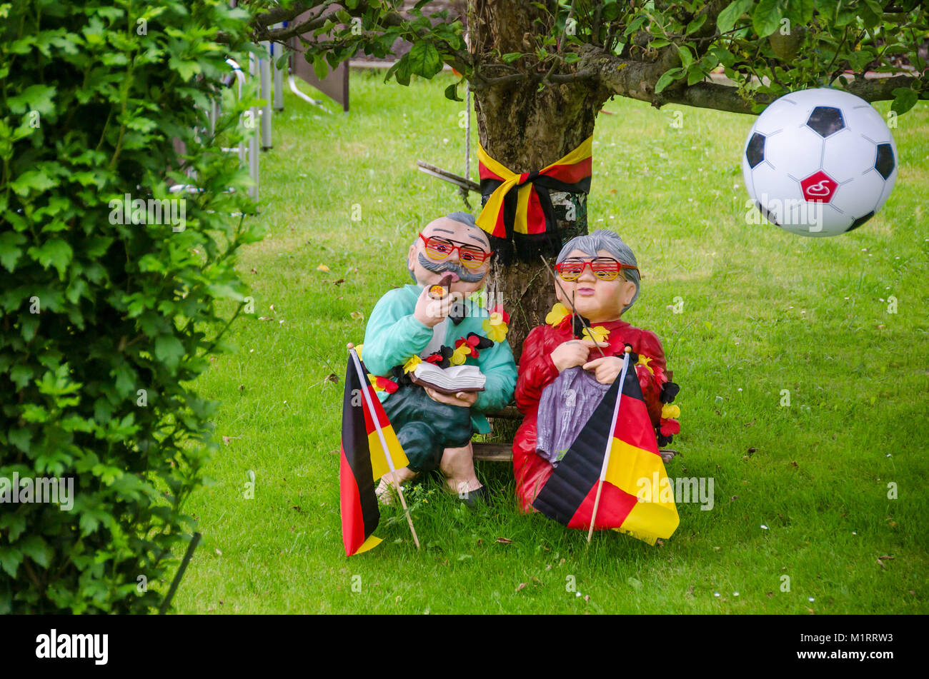 Berlin, Germany - July 2, 2016: German football fans decorated their garden with flags and balls looking forward - Stock Image