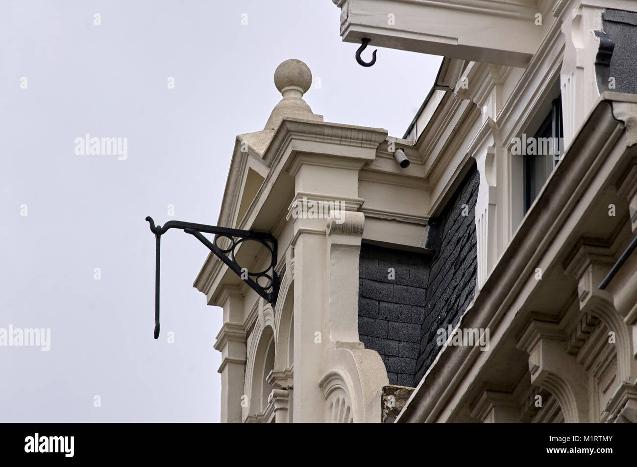Building hooks or' Winchbeams' on top of Dutch Buildings in Amsterdam, Holland, The Netherlands. - Stock Image