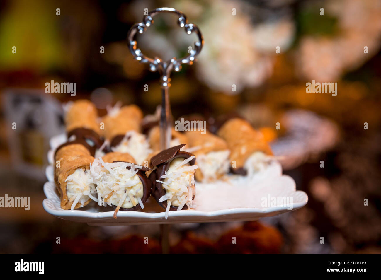 Cannoli at the Desert station at a dinner party buffet, Naples, Florida, USA - Stock Image