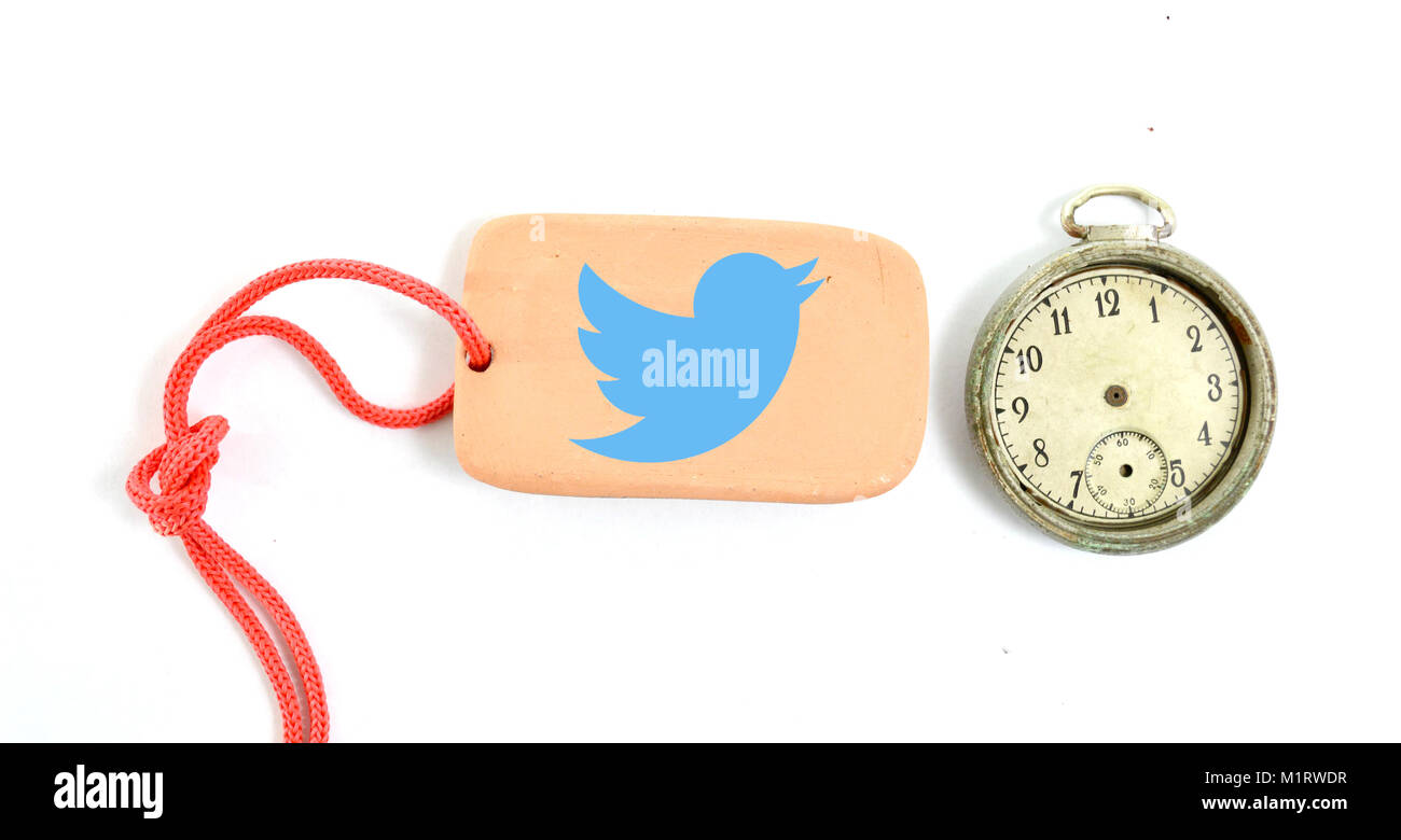 RESEN, MACEDONIA- JANUARY 21, 2018: Twitter logo on a clay plate and vintage clock .Twitter social network for public - Stock Image