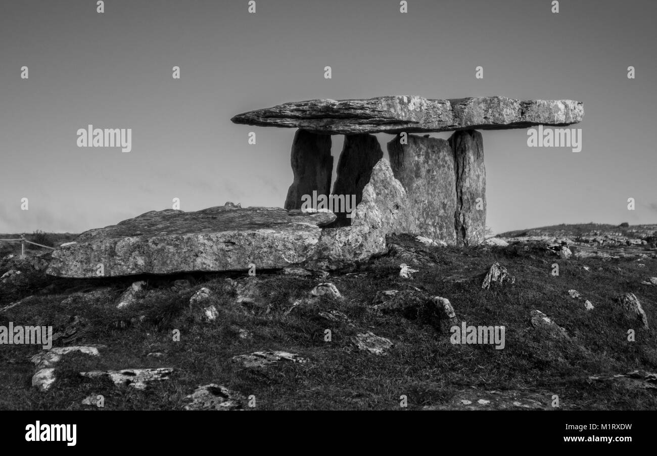 The Poulnabrone Dolmen stands its silent and lonely watch in remote Ireland. - Stock Image