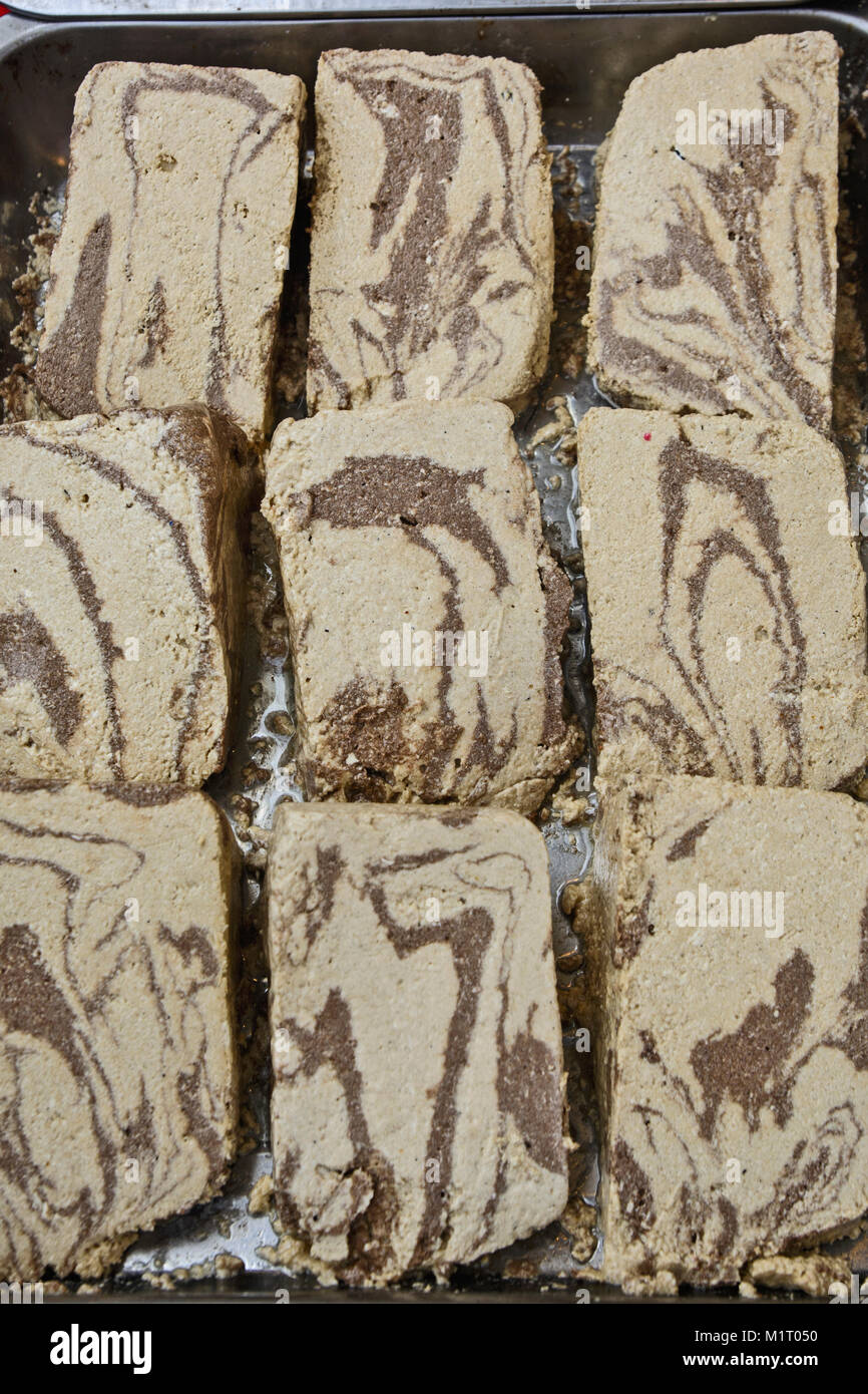 Several pieces of homemade halva exposed to views and sales. - Stock Image