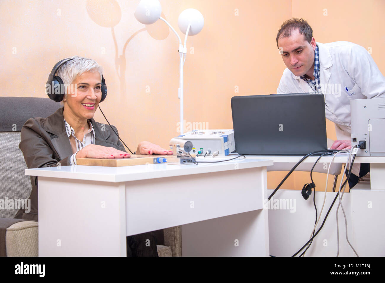 Older woman using alternative medicine - Stock Image