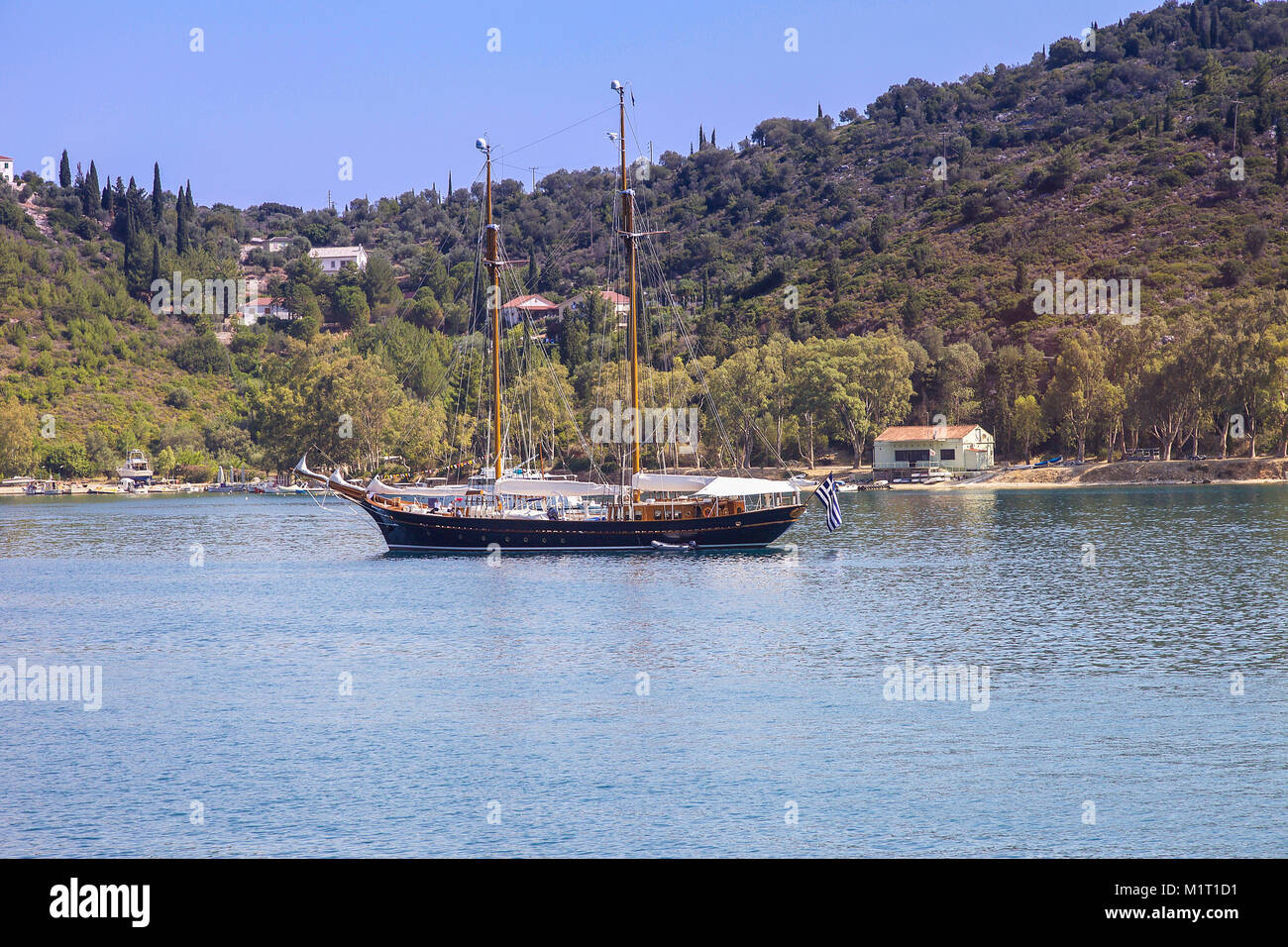 Ithaca -  Greece July 13 -  Big wooden sailboat anchored in a bay on the island of Ithaca off the northeast coast Stock Photo