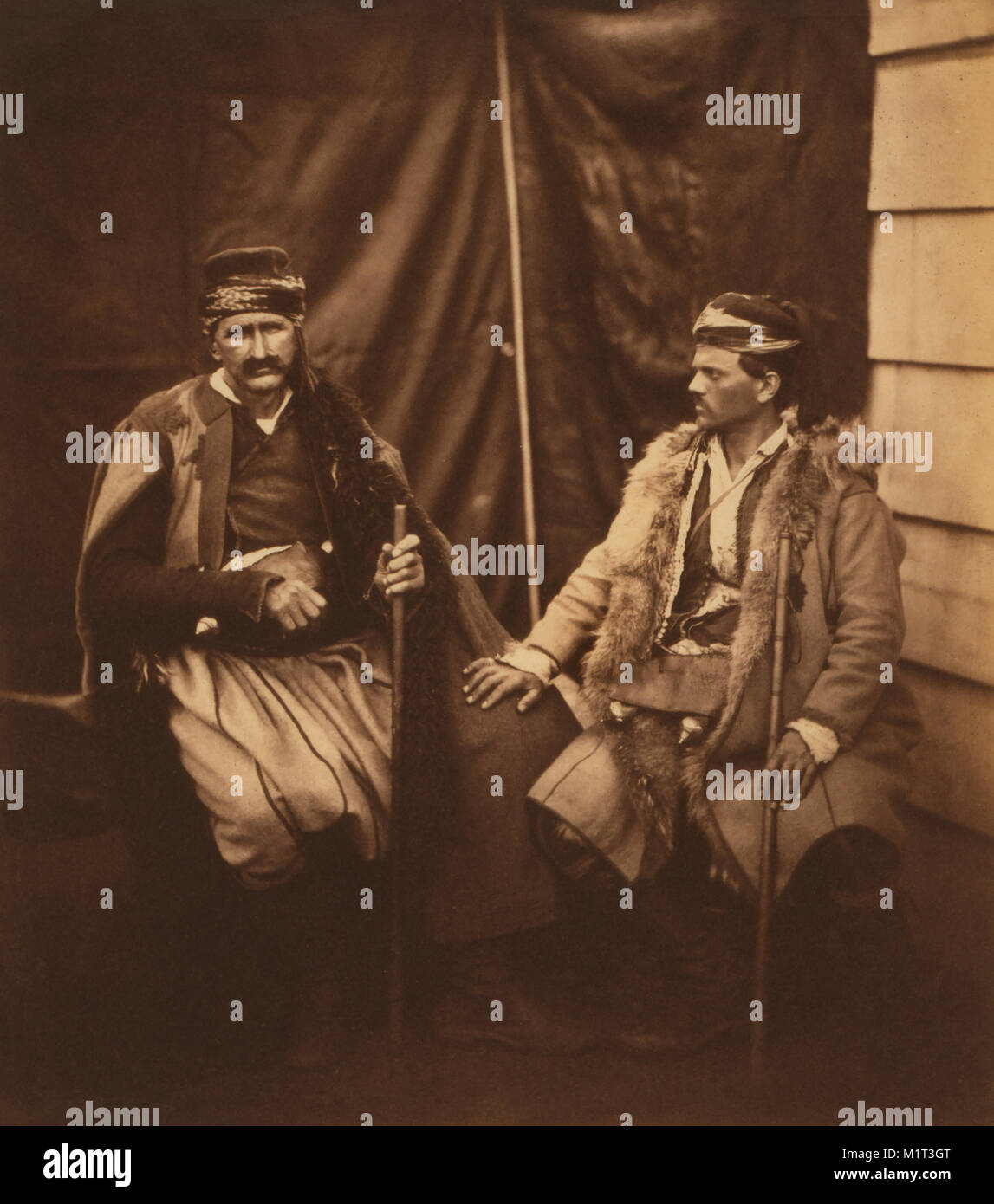 Discussion between two Croats, Full-Length Seated Portrait, Crimean War, Crimea, Ukraine, by Roger Fenton, 1855 - Stock Image