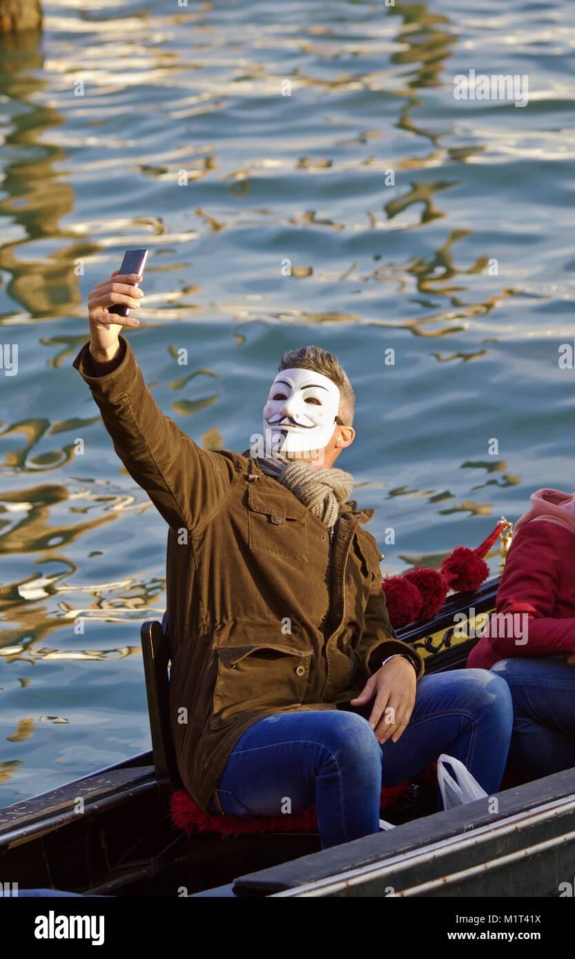 Venice carnival Reveller takes a selfie V - Stock Image