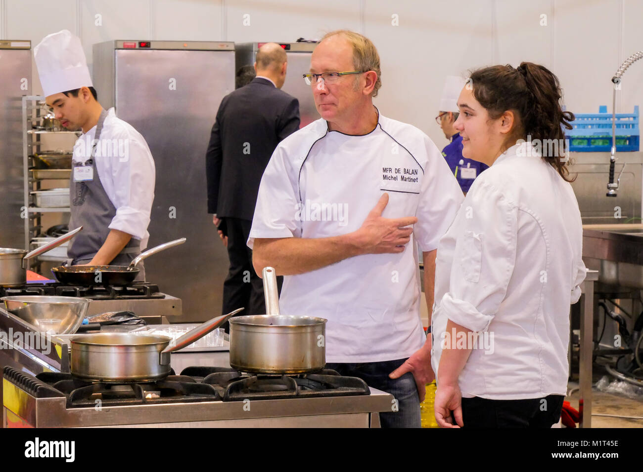 Young apprentices cookers at Job fair, Lyon, France - Stock Image