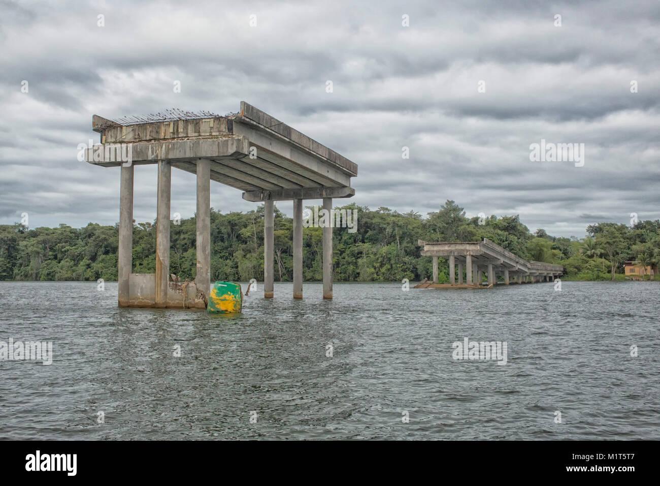 New concrete bridge on river in Suriname is broken down Stock Photo