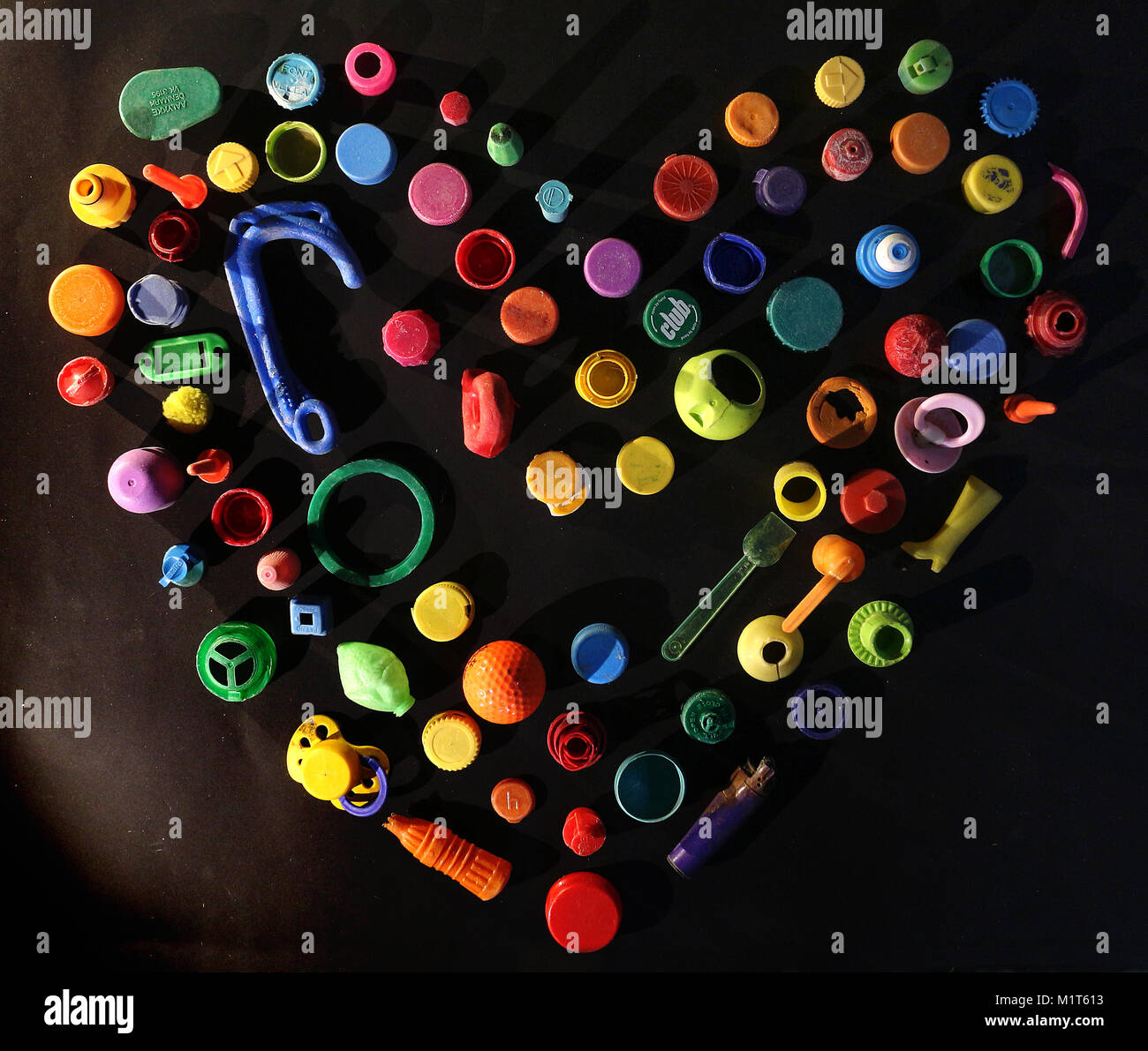 Colourful plastic heart of rubbish created by Giles W Bennett - Stock Image