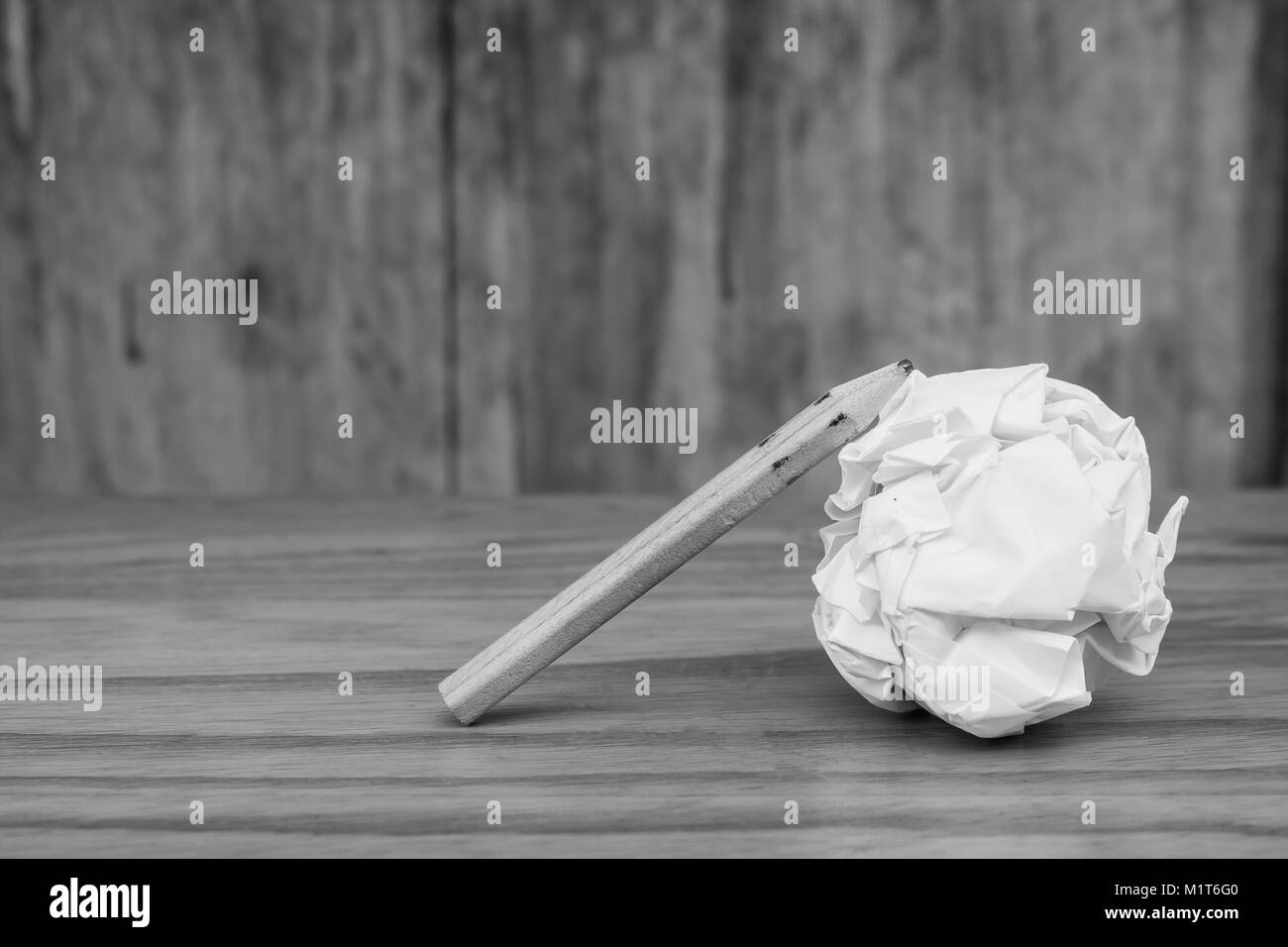 Business Creative and Idea Concept Top view of three pencil with white crumpled paper ball put on wooden floor in - Stock Image