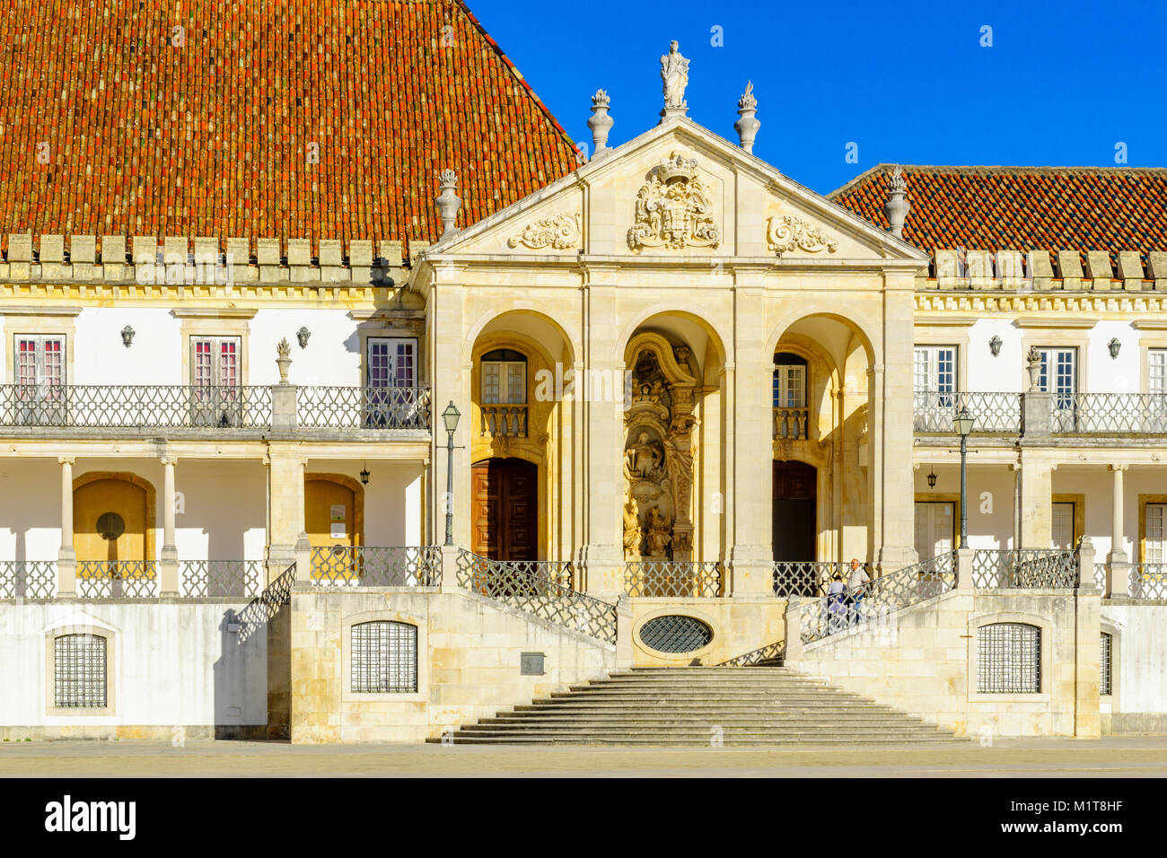 COIMBRA, PORTUGAL - DECEMBER 23, 2017: The Jesus College building in the old university, with visitors, in Coimbra, - Stock Image