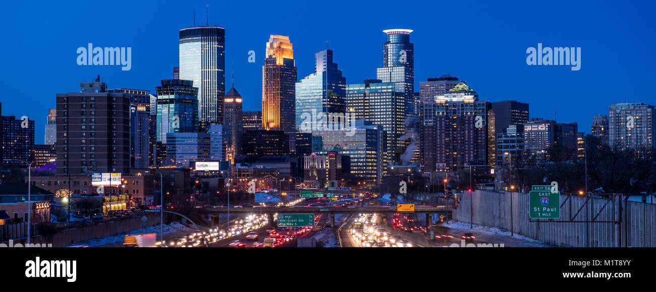 Twilight descends on downtown Minneapolis, Minnesota, as seen from the south with interstate 35W in the foreground. - Stock Image