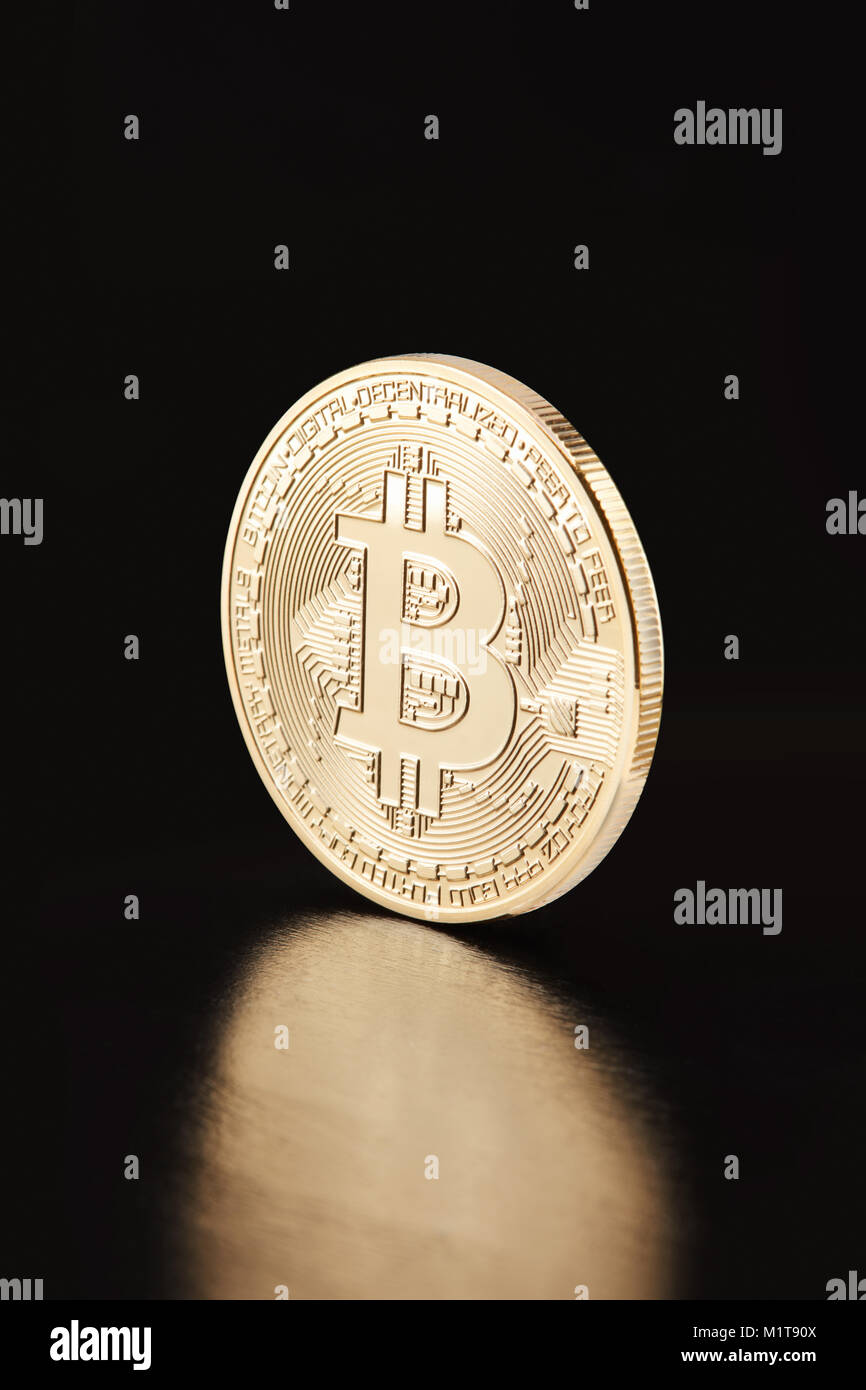 Golden Bitcoin, coin on black, clipping path - Stock Image