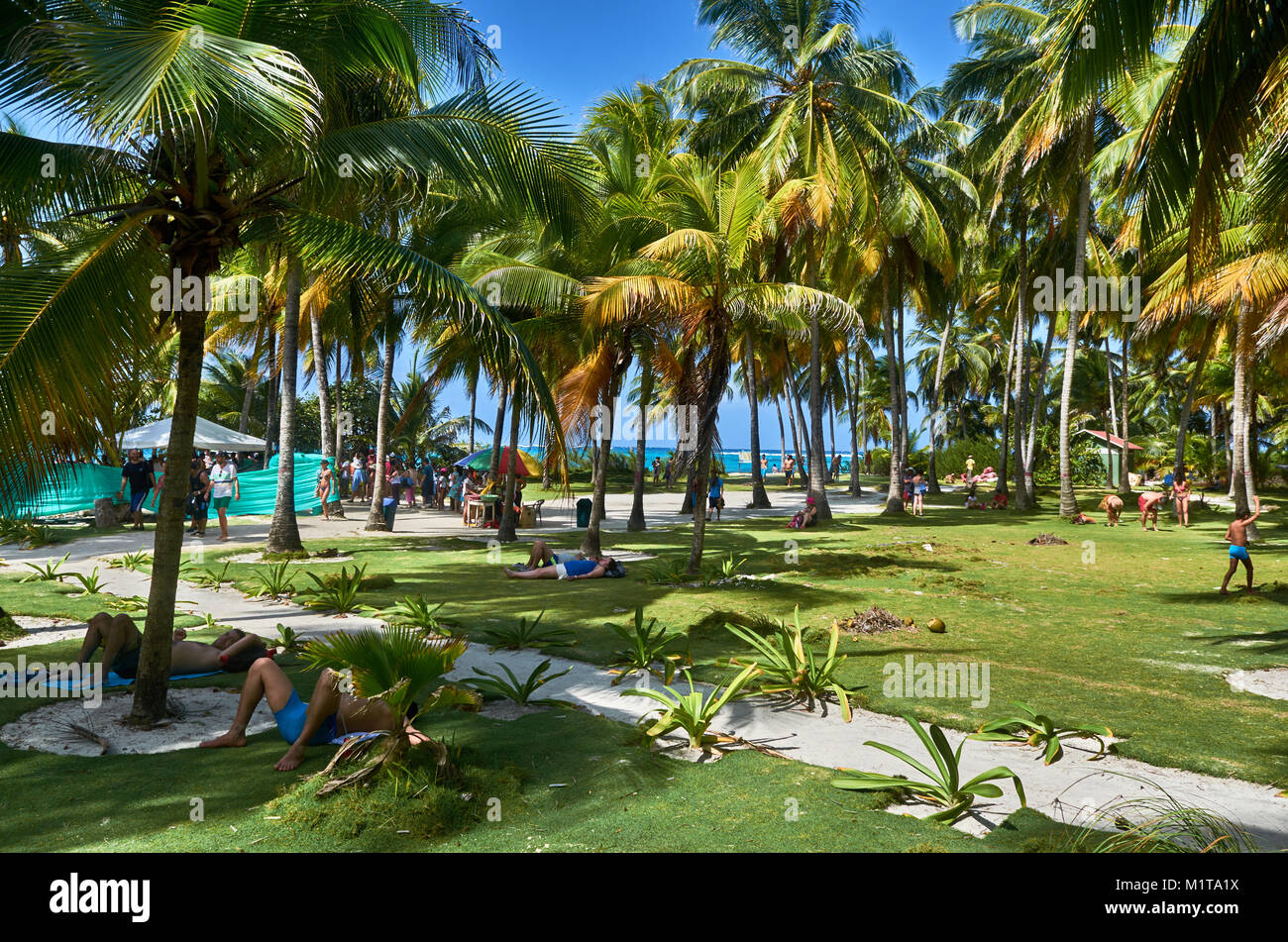 JOHNNY CAY, COLOMBIA - JANUARY 09, 2015: People resting and having a nice time in the island of Johnny Cay. Stock Photo