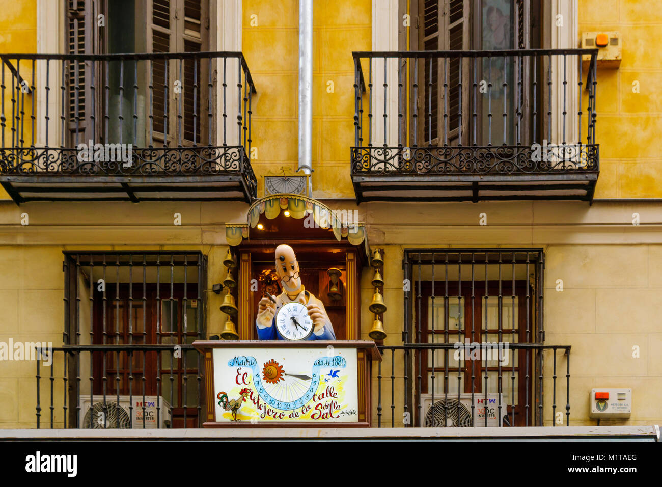 MADRID, SPAIN - DECEMBER 31, 2017: Figure of a clockmaker, marking an historical clock shop, in Madrid, Spain - Stock Image