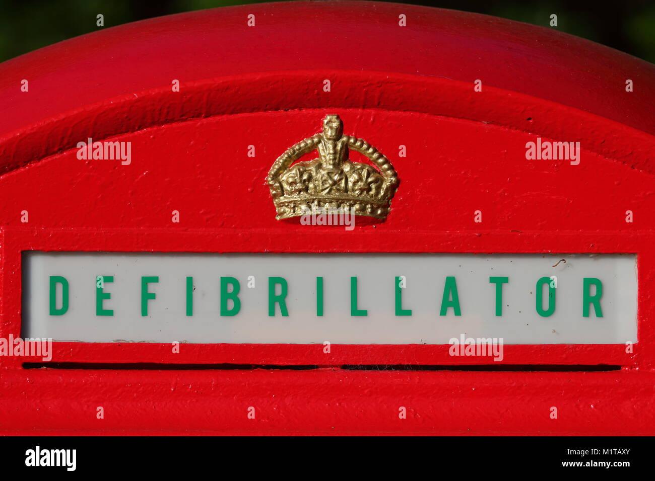 Red Telephone Box Defibrillator - Stock Image
