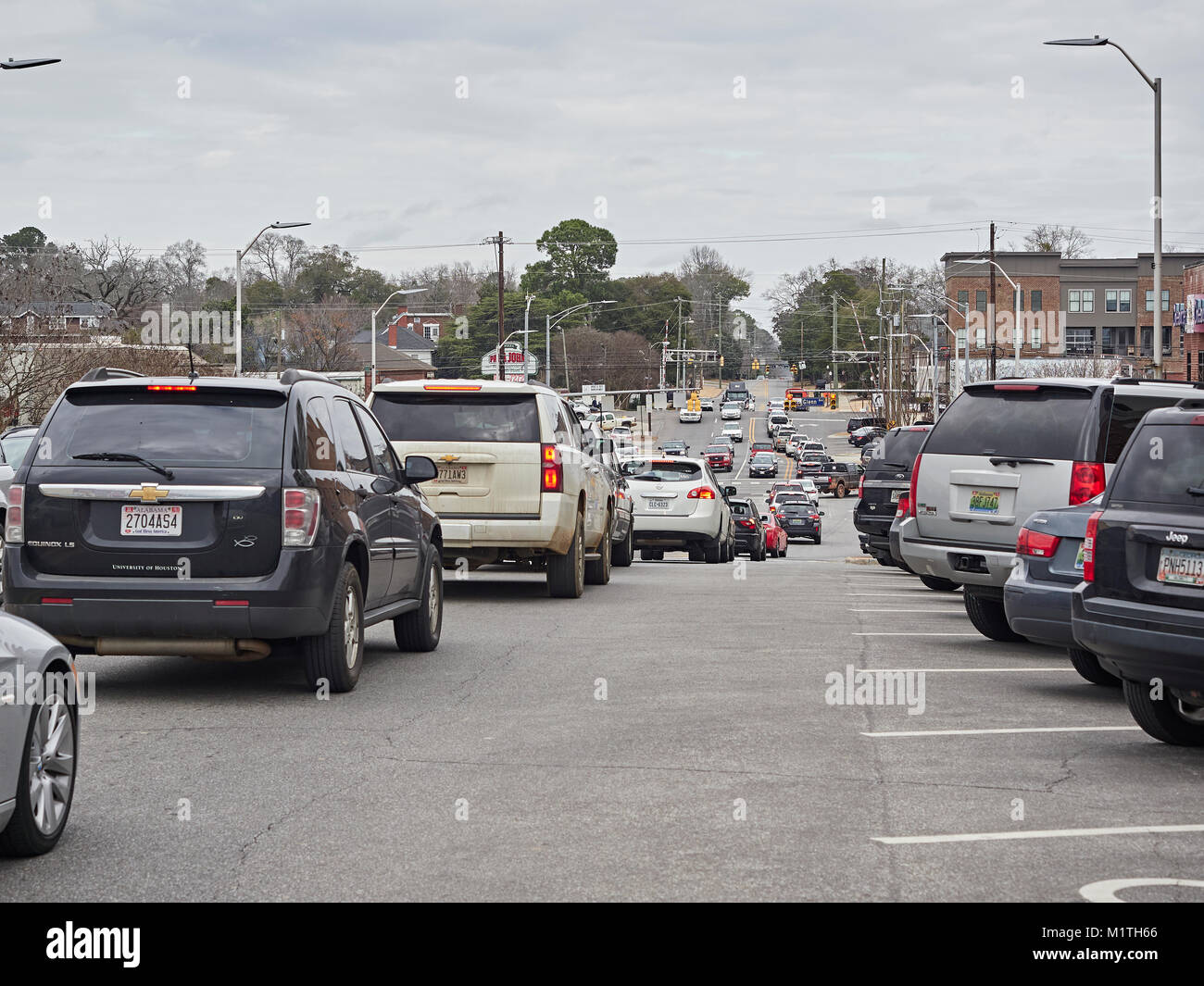 Vehicle traffic on College Street backed up in gridlock in the small town of Auburn Alabama, United States. - Stock Image