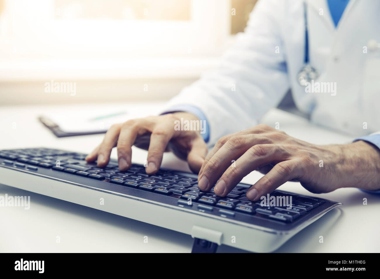 doctor typing on computer keyboard in office. online consultation Stock Photo