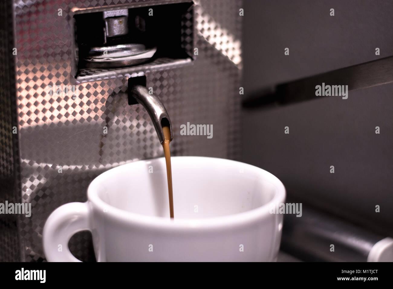 Pouring espresso coffee - Stock Image