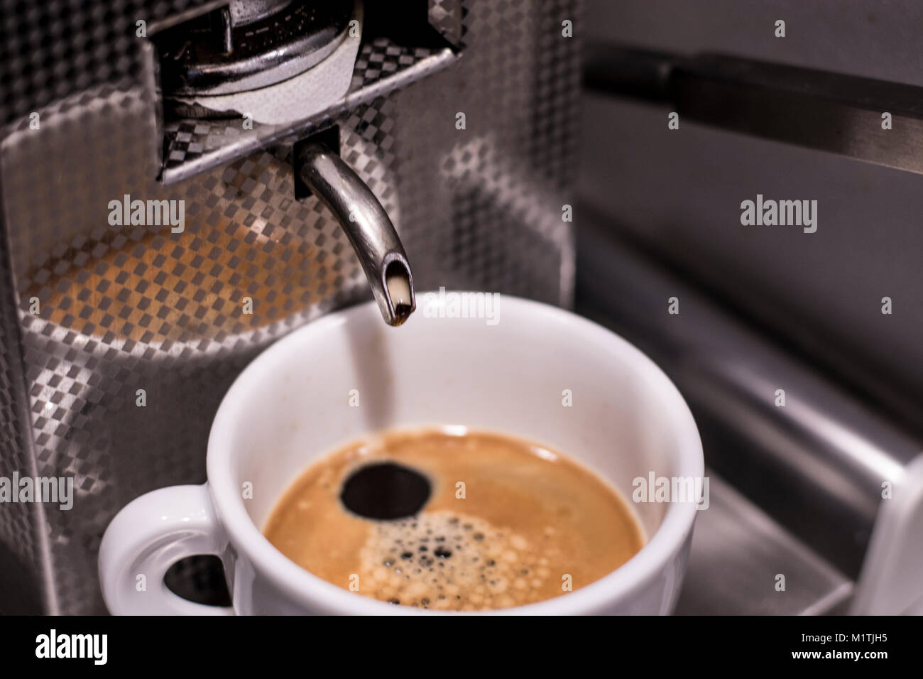 Espresso machine with cup of coffee - Stock Image