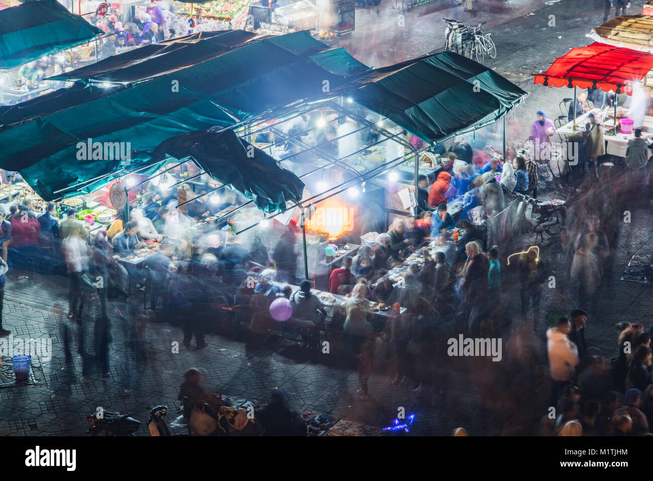 Busy food stall with motion blur at Jamaa El Fna market square in MEdina,Marrakesh,Morocco Stock Photo