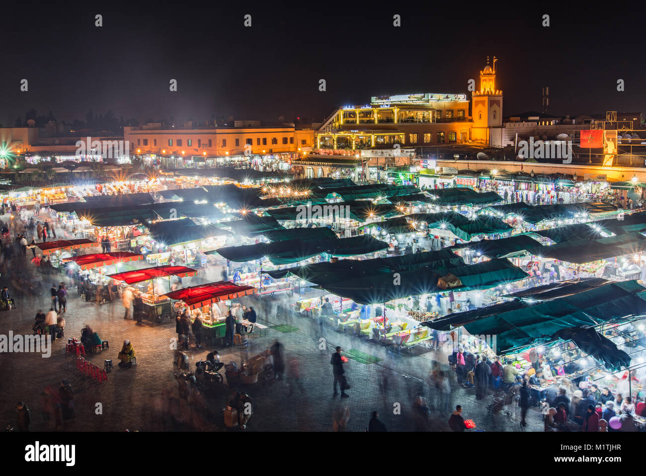 Crowded famous market in Medina of Marrakesh,Jamma El Fna,Morocco. Aeriel view at night,motion blur. Stock Photo