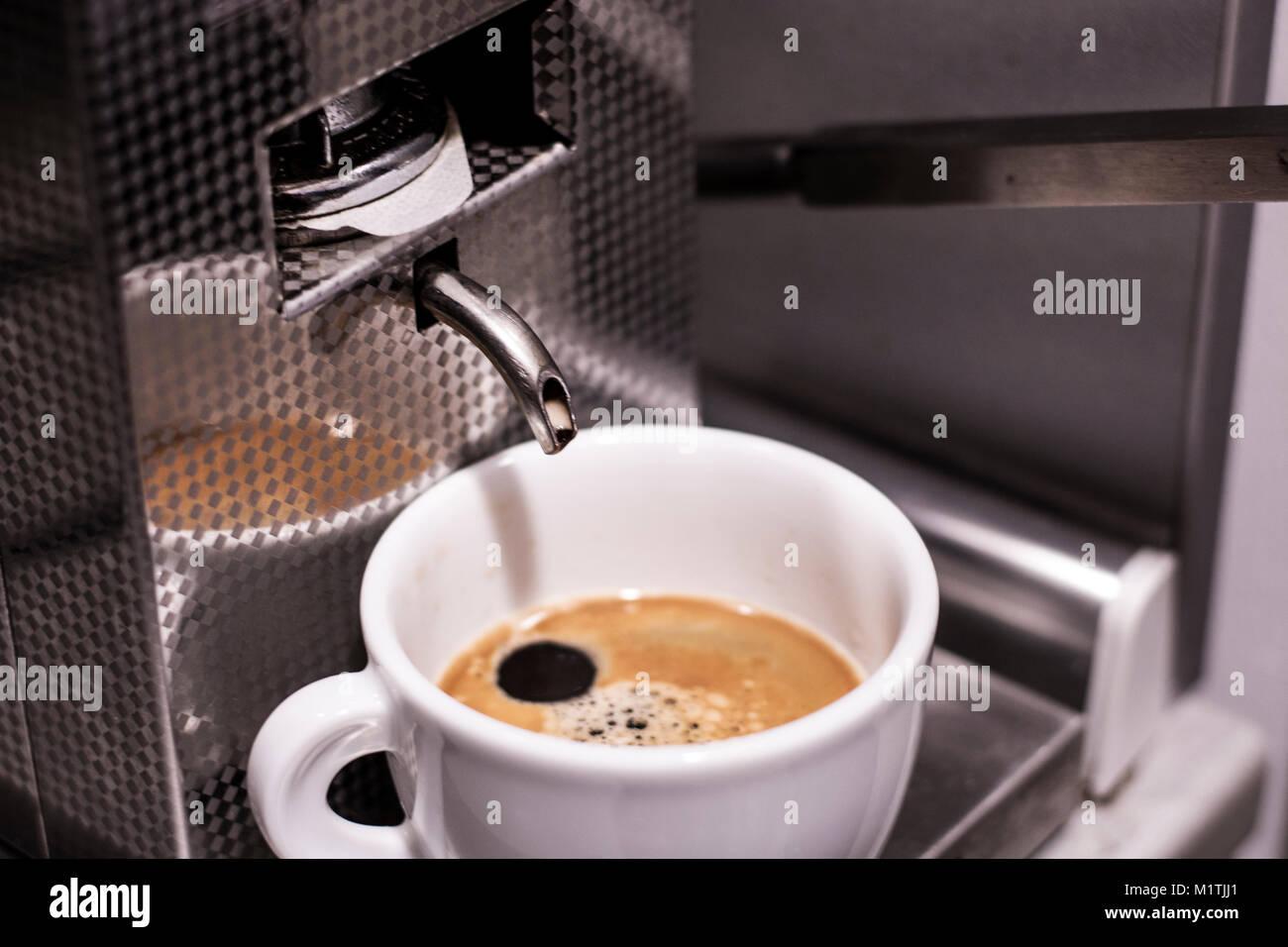 Fresh espresso in a white coffee cup - Stock Image