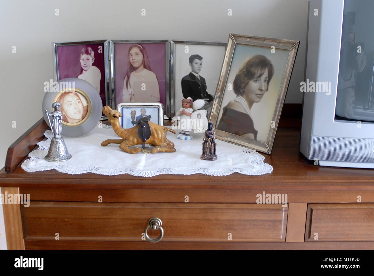 still life of family framed photos - Stock Image