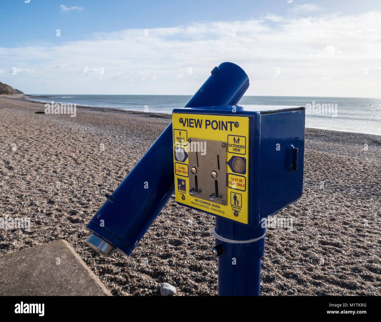 A Viewpoint telescope on the seafront at Seaton, Devon. - Stock Image