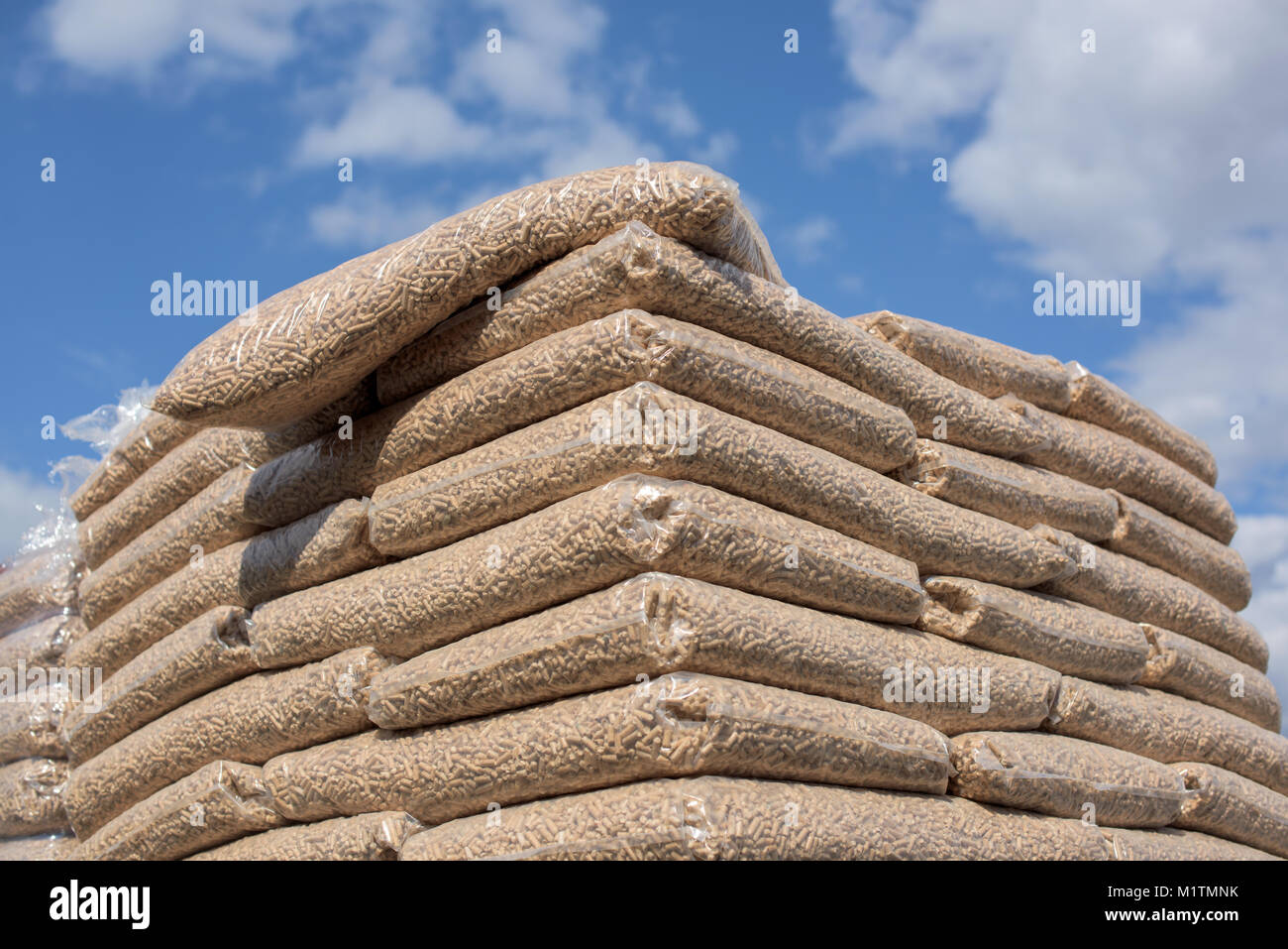 Heap of bags with wooden pellet biomass - Stock Image