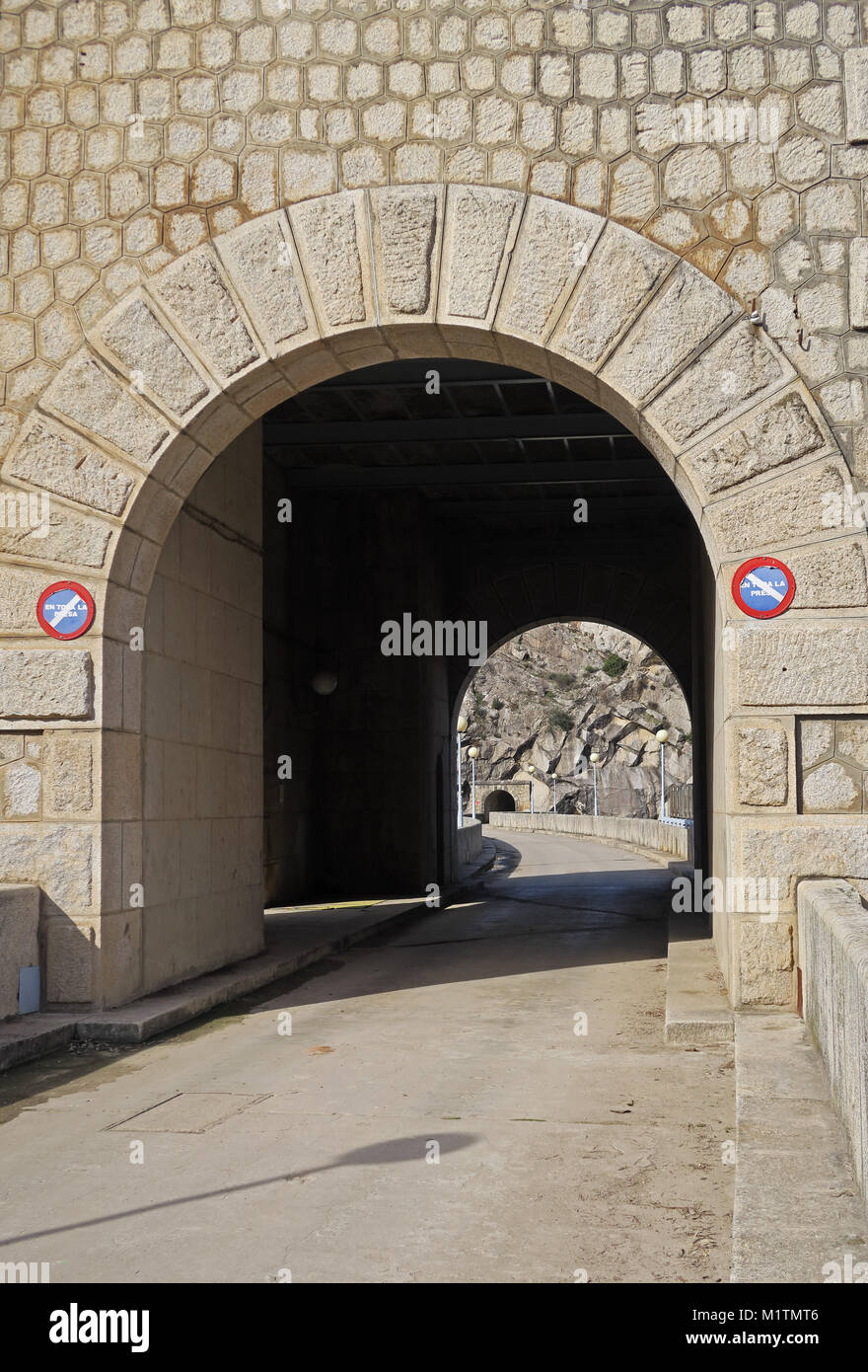 view through tower in middle of dam to tunnel under mountainside  Embalse del Jandula, Parque Natural Sierra de - Stock Image