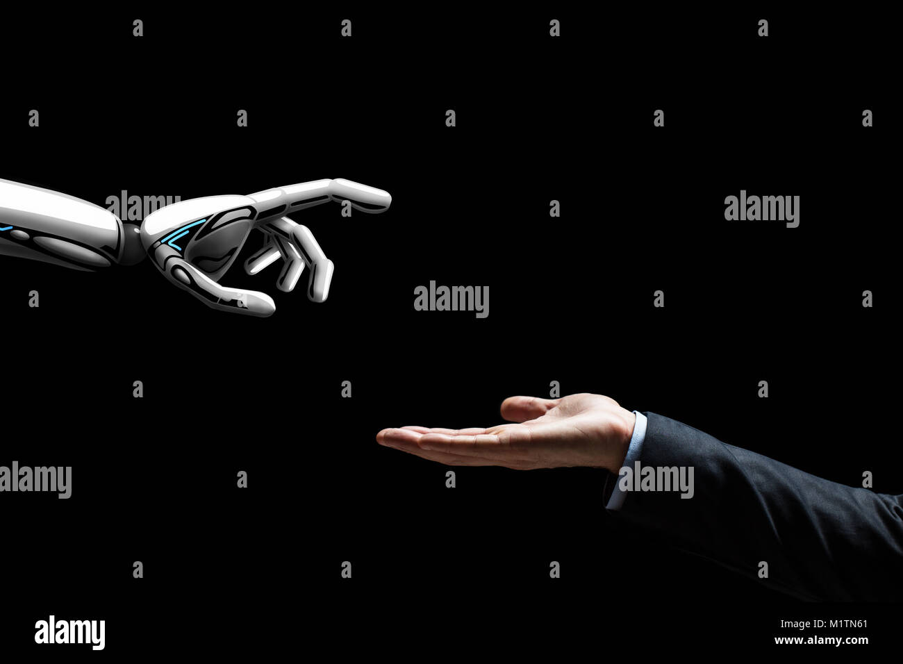 robot and human hand on black background - Stock Image
