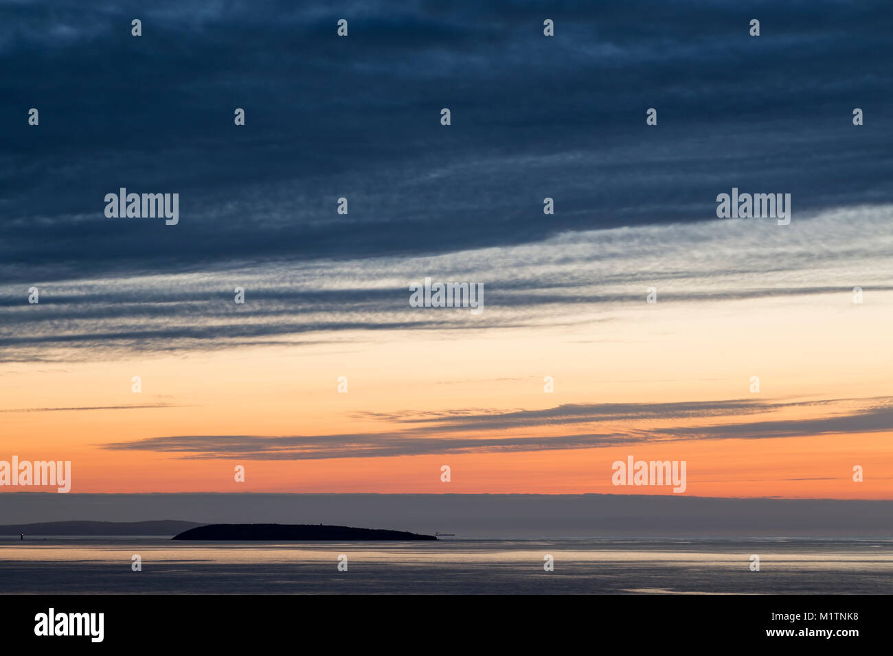 Silhouete of Puffin Island set in the Irish sea, shot from North Wales. - Stock Image