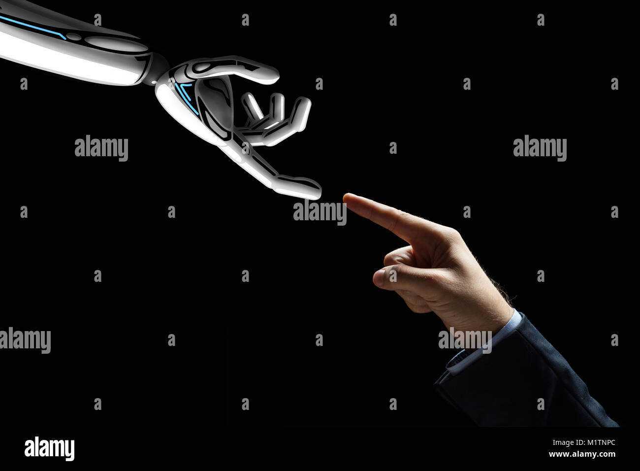 robot and human hand connecting fingers Stock Photo