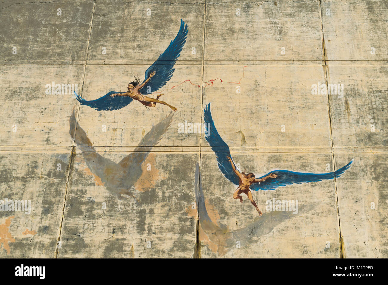 Daedalus and Icarus artwork on a wall - Stock Image