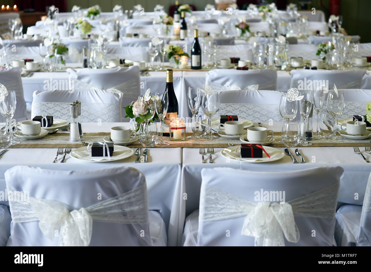 Wedding breakfast tables set up for the reception feast. - Stock Image