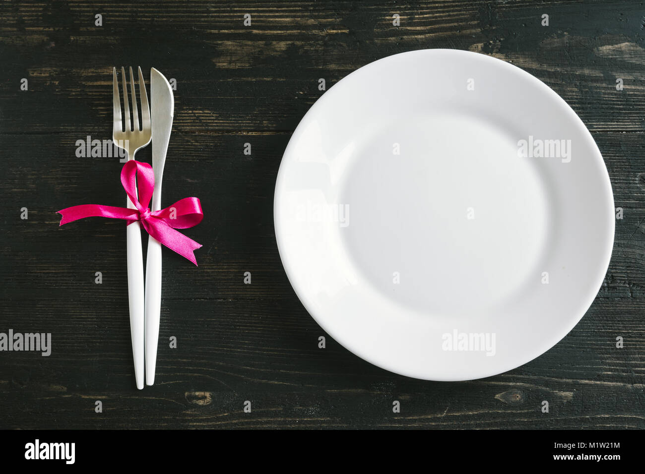 Romantic Table Setting With White Plate Modern Cutlery And Red
