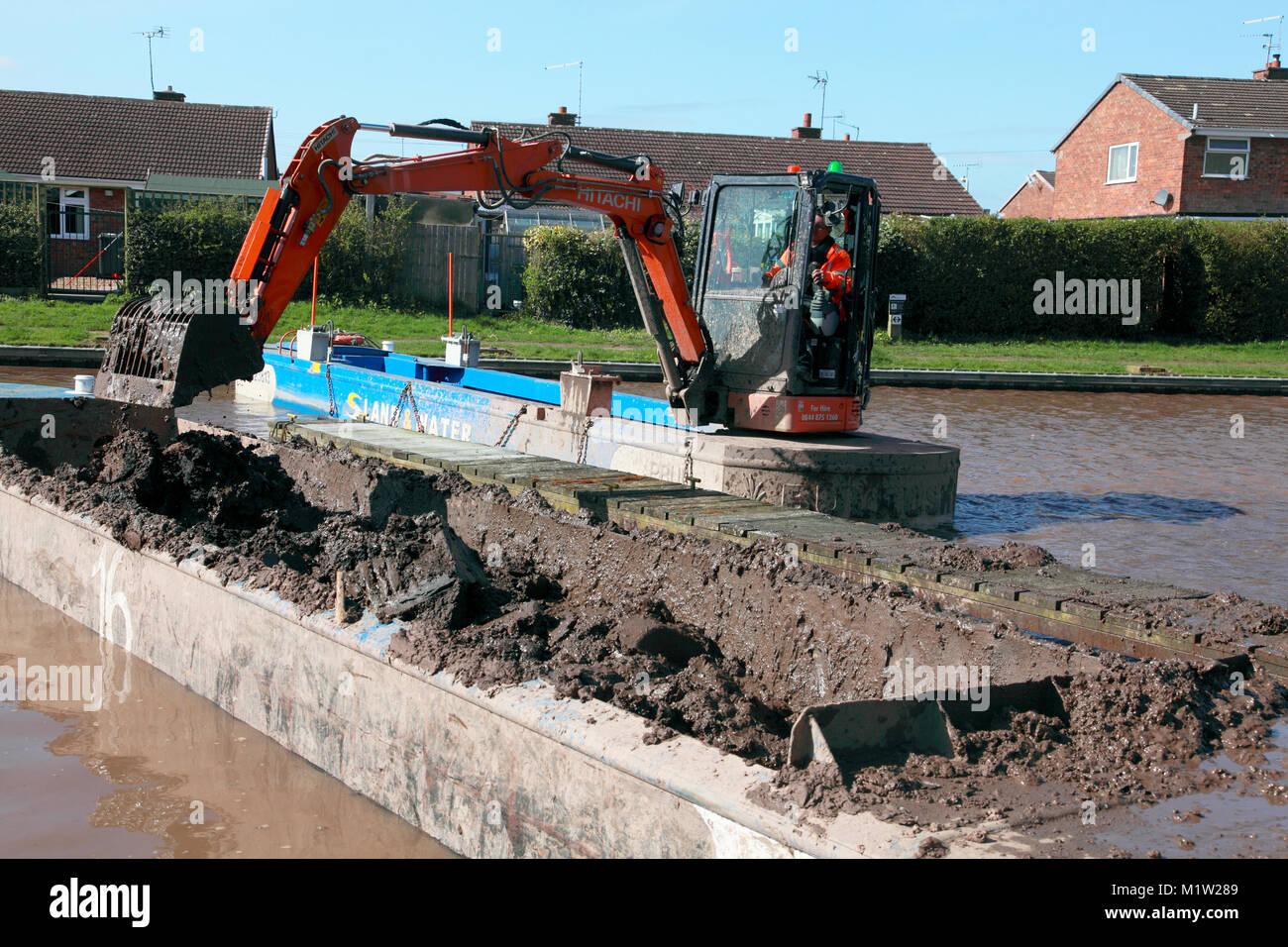 Dredging the Shropshire Union Canal at narrowboat moorings in Market Drayton Shropshire - Stock Image