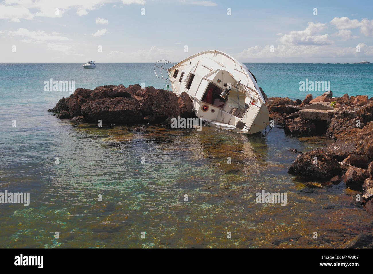 Yacht which has crashed. Pointe-du-Bout, Martinique - Stock Image