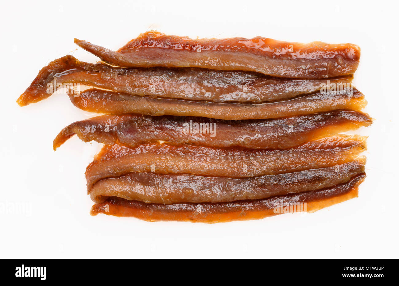 High Angle View of Anchovy Fillets against White Background - Stock Image
