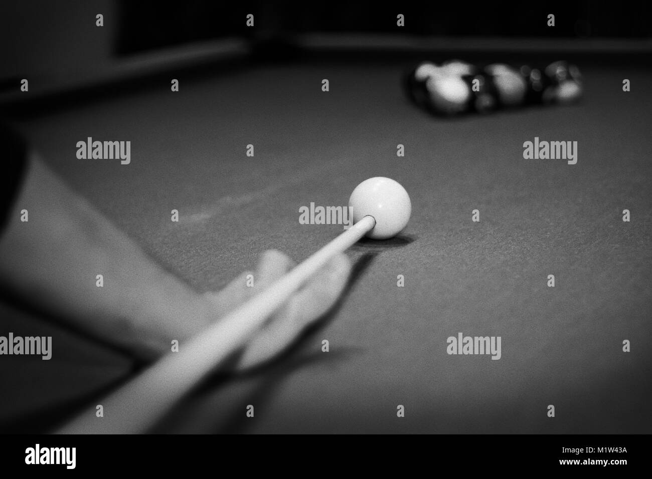 a man playing billiard pull black and white - Stock Image