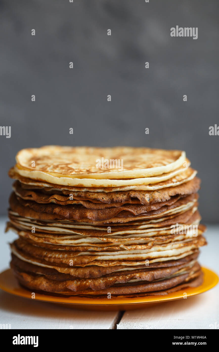 High stack of classic Russian thin pancakes. Rustic style. Traditional for the Russian pancake week Maslenitsa . - Stock Image