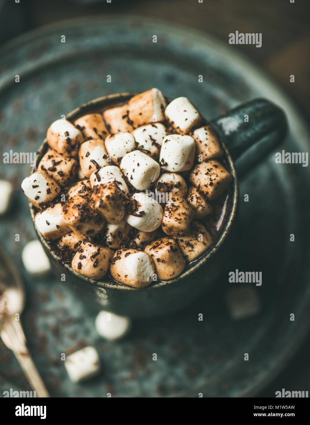 Winter warming hot chocolate with marshmallows in mug - Stock Image