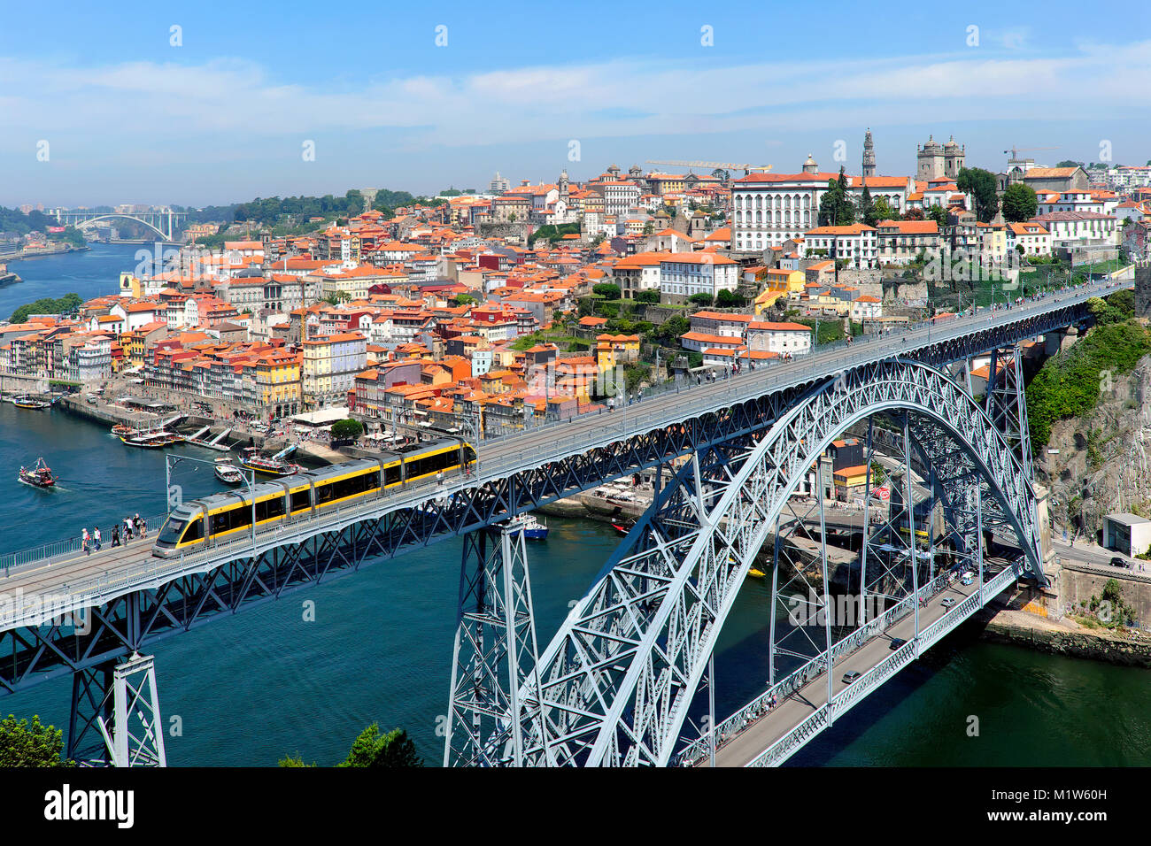 Metro train crossing the Douro River over Dom Luís I Bridge, Porto, Portugal - Stock Image
