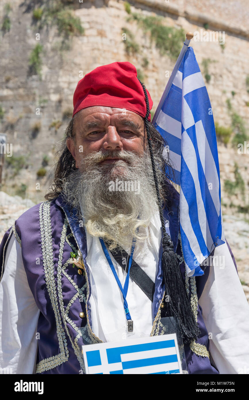 Greek character outside walls of The 16th century Venetian Fortezza, Rethymnon (Rethimno), Rethimno Region, Crete - Stock Image