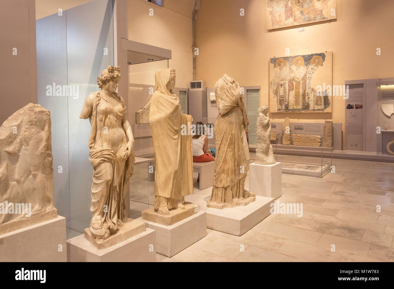 Ancient marble statues and frescoes inside Archaelogical Museum of Rethymno, Old Town, Rethymnon (Rethimno), Crete - Stock Image