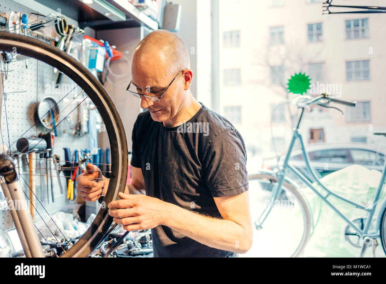 Small business owner of bicycle store - Stock Image