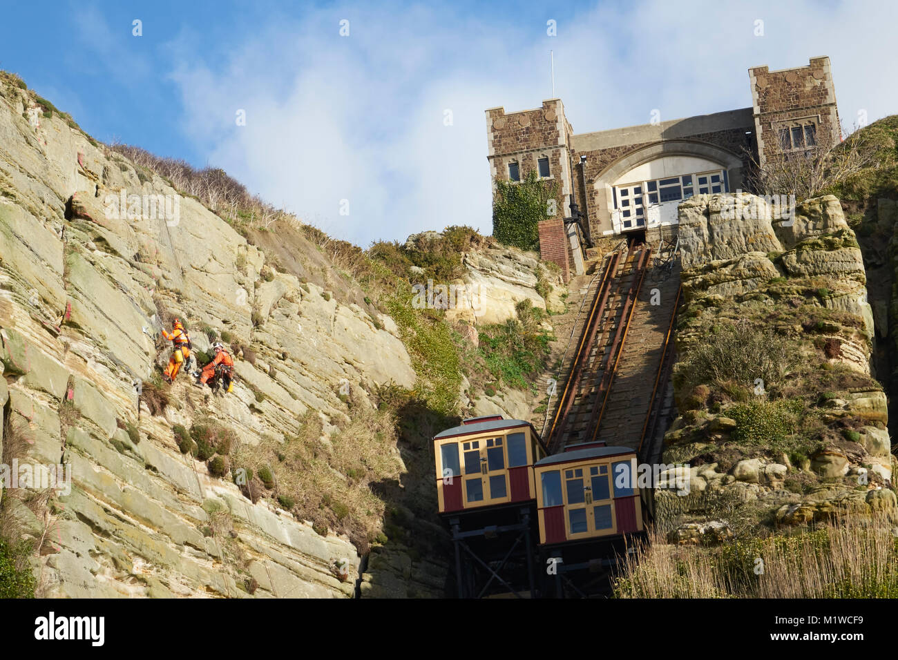 Hastings, specialist workmen stabilising East Hill cliff face, by the cliff lift, Rock-a-Nore, East Sussex, UK - Stock Image