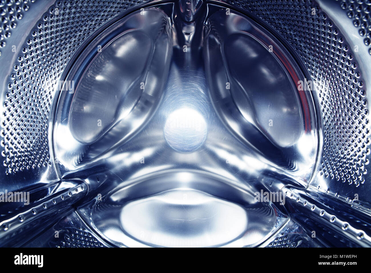 closeup of drum in washing machine, new technology - Stock Image