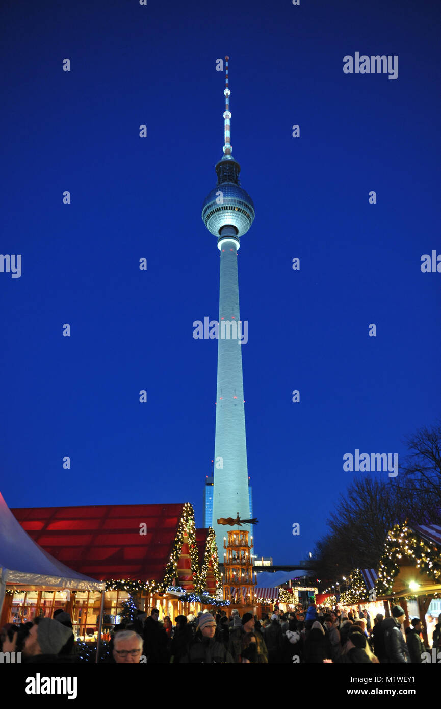 Photo of Berliner Fernsehturm - Television Tower, Berlin taken from the with Christmas market 'Berliner Weihnachtszeit' - Stock Image